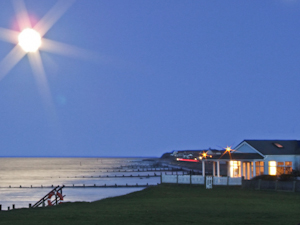 moonlit beach house